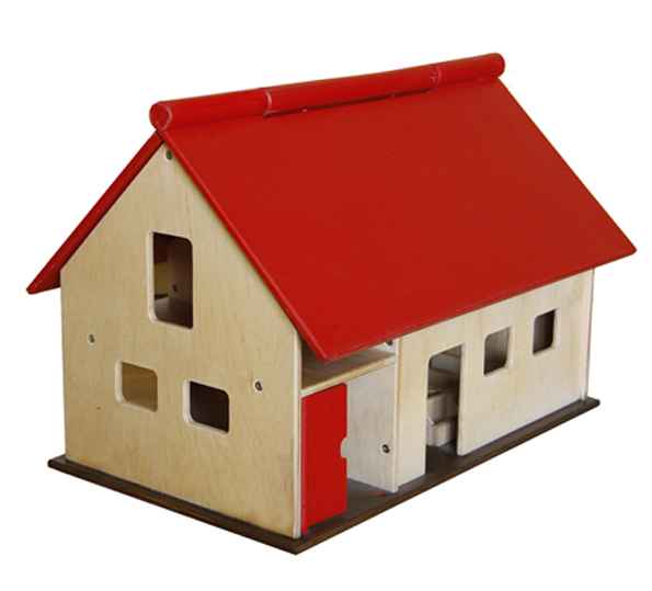 A wooden toy farm house